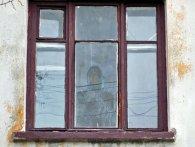 На вікні квартири, де жив загиблий боєць АТО, проявився образ Богородиці